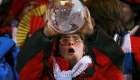Participants celebrate the opening of the Special Olympics World Winter Games on Saturday, February 7, 2009 in Boise, ID. An athlete from Spain holds an inflatable global before handing it to a global messenger during the parade of athletes.